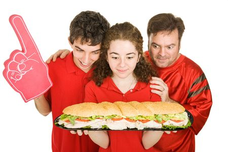 Hungry people at a football party, looking at a giant submarine sandwich.  Isolated on white. Stock Photo - 3620396
