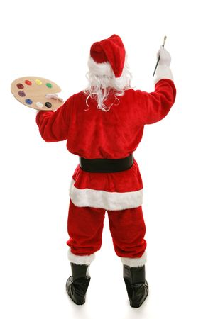 Full body rear view of Santa Clause painting with his artist palette and paintbrush.  Isolated on white.