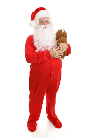 classic santa: Santa Clause in footy pajamas with his teddy bear.  Full body isolated on white. Stock Photo