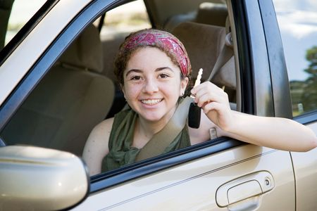 Cute teen girl excited to have the car keys.   Stockfoto