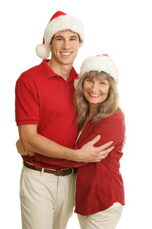 single mother: Portrait of proud single mother and handsome young adult son at Christmas time.  Isolated on white.