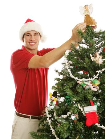 Tall handsome young man decorating the Christmas tree.   Stock Photo - 3682239