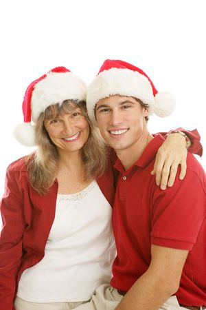 Pretty middle aged mom and her handsome college aged son, together for Christmas.  White background.   photo