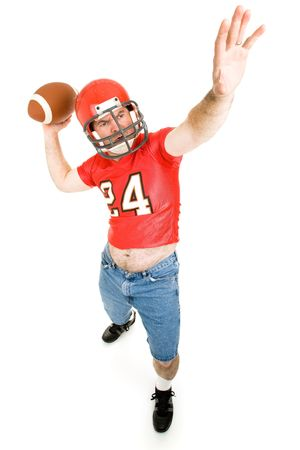 fanatic: Middle aged man in high school football uniform, getting ready to throw a long pass.  Full body isolated on white.