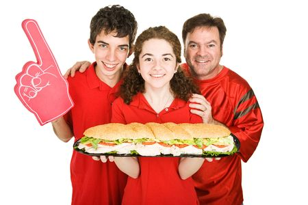 Sports fans getting ready to chow down on a giant submarine sandwich.  Isolated on white.   photo
