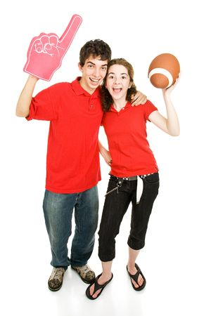 Teen couple roots for their football team.  Full body isolated on white.   Stock Photo