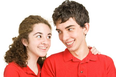 Cute teen couple in love against a white background.   photo
