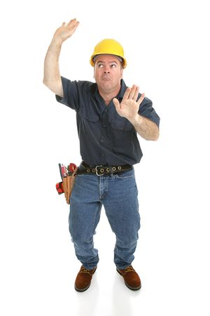 Construction worker trapped in imaginary box.  Full body isolated on white. photo