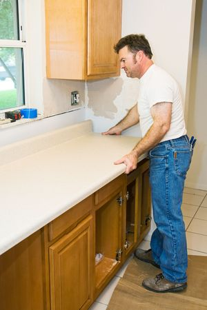 workmanship: Contractor remodeling kitchen, installing cabinets and counter top.