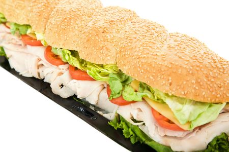 hoagie: Closeup photo of a giant turkey hoagie sandwich on white background.