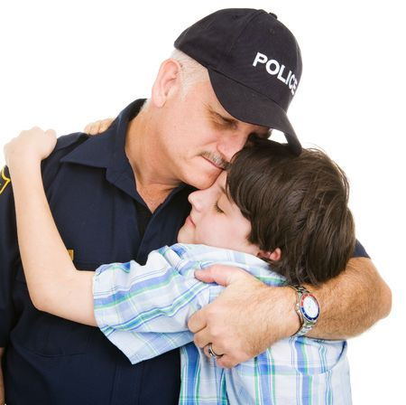 Policeman hugging an adolescent boy.    Isolated on white.   Reklamní fotografie