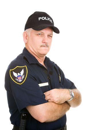 grumpy: Oudere politieagent met een verdachte meningsuiting. Geïsoleerd op wit. Stockfoto