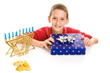 Happy little boy excited about opening his hanukkah gift.  Isolated on white. Stock Photo