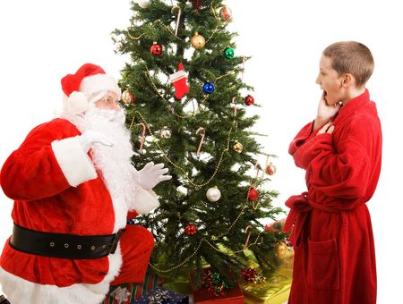 Little boy catches Santa in the act of bringing Christmas presents.  White background Stock Photo - 3876407