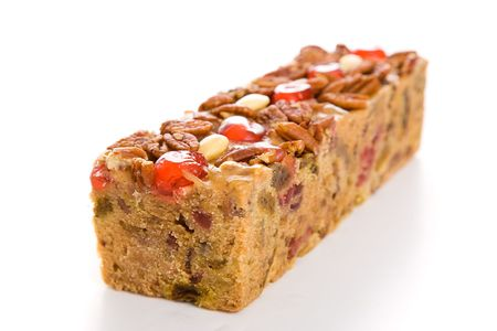 fruitcake: Moist, delicious Christmas fruitcake isolated on white background.