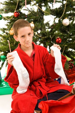 christmas sock: Little boy disappointed to get socks for a Christmas gift.