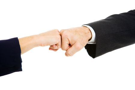 bump: Female and male business people giving a fist bump.  Isolated on white. Stock Photo