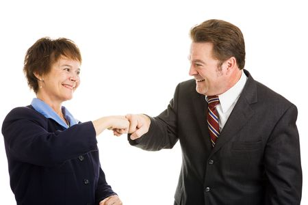 Happy business partners giving each other a fist bump.  Isolated on white.   photo