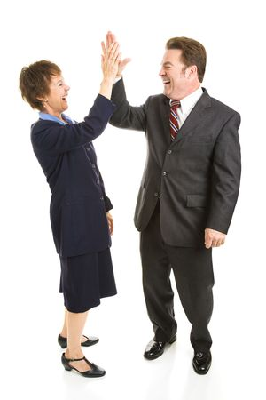 Male and female business people slapping eachother high five.  Full body isolated on white.   photo