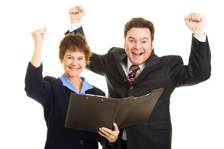 Male and female business partner ecstatic about their latest financial report.  Isolated on white.   photo