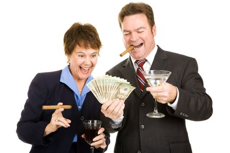 Business partners holding a wad of cash while smoking cigars and drinking cocktails.  Isolated.   photo