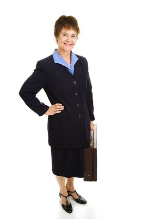 Full body view of a pretty, smiling businesswoman holding her briefcase.  Isolated on white.   photo