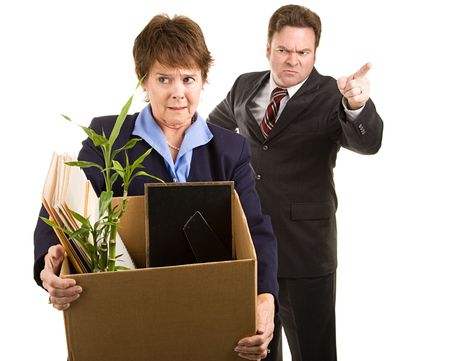 work out: Fired corporate employee holding her belongings in a cardboard box, as her boss orders her out of the building.  Isolated on white.   Stock Photo