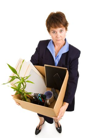 layoffs: Woman laid off from work, carrying her belongings in a box.  Full body isolated on white.   Stock Photo