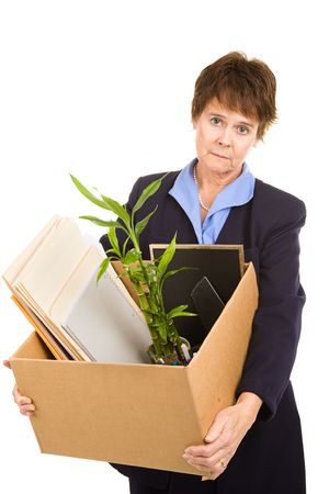 Middle aged woman laid off from her white collar job carries a box of her belongings.  Isolated on white.  photo