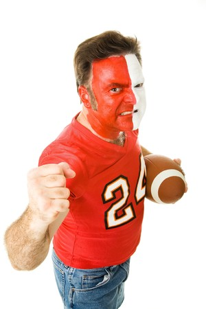 Football fan in face paint and jersey waving his fist aggressively.  Isolated on white.