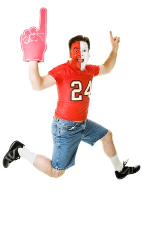 Enthusiastic sports fan jumping for joy over his teams success.  Full body isolated on white.