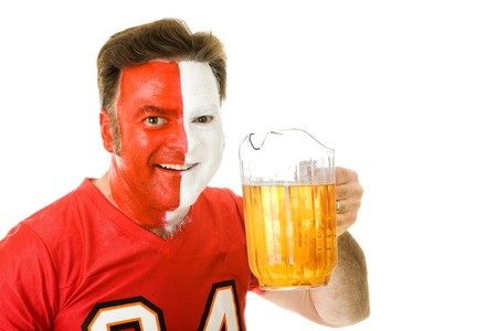 Thirsty sports fan with painted face, holding a pitcher of beer.  Isolated on white. photo