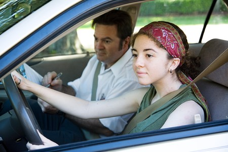 instructor: Teen girl taking driving test to get her drivers license.