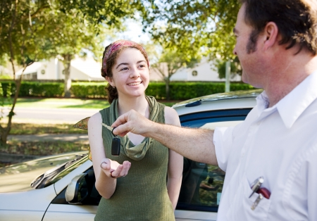pass test: Young woman being handed the car keys by her father or driving instructor.