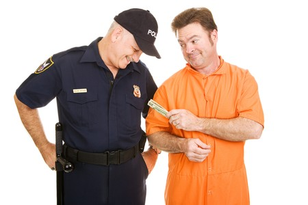 inmate: Inmate in orange jump suit offering a bribe to a police officer.  Isolated on white.