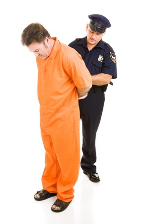 Police officer placing handcuffs on prisoner in orange prison jumpsuit.  Full body isolated on white.   Stock Photo - 4053914