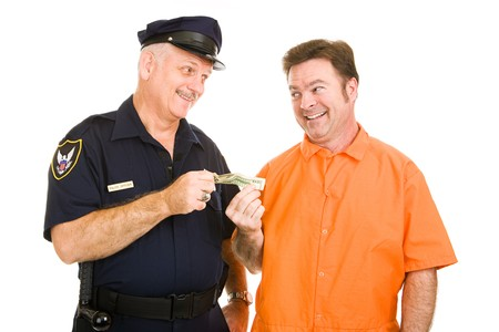 an inmate: Police officer accepts cash bribe from a prison inmate.  Isolated on white.