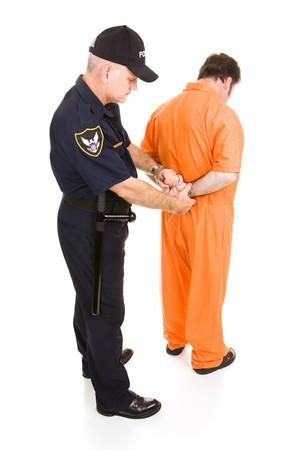 with orange and white body: Preso en overoles naranja se est� esposado por la polic�a. Aislados de todo el cuerpo blanco.