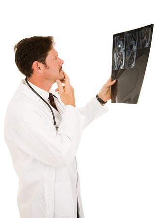 Handsome doctor reviewing the results of a patient's MRI.  Isolated on white.