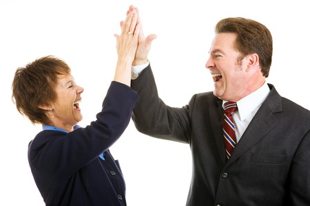 Enthusiastic business partners giving each other a high five.  Isolated on white.   Stock Photo