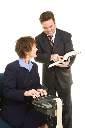 precedent: Court reporter and attorney reviewing legal precedent in a book.  Isolated on white.   Stock Photo