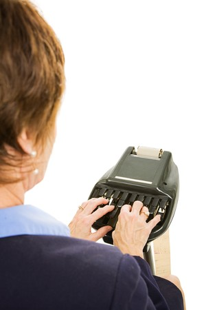 over the shoulder view: Over the shoulder view of a court reporter using stenography machine.  Isolated on white.