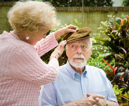 Loving wife cares for her elderly husband with alzheimers disease.   photo