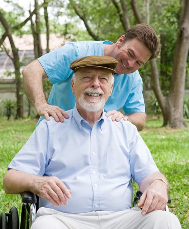 hospice: Disabled senior man enjoying a relaxing massage from his physical therapist.   Stock Photo
