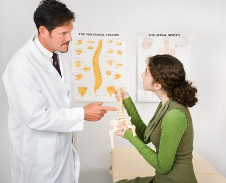 Young patient visiting a chiropractor for the first time. photo