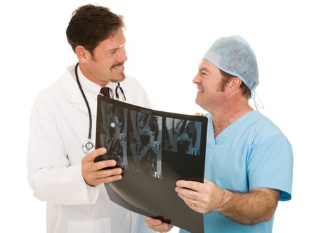 Doctor thanking radiologist for giving him MRI test results.  Isolated on white.