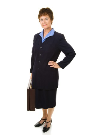 navy blue suit: Pretty, mature businesswoman with her briefcase.  Full body isolated on white.   Stock Photo