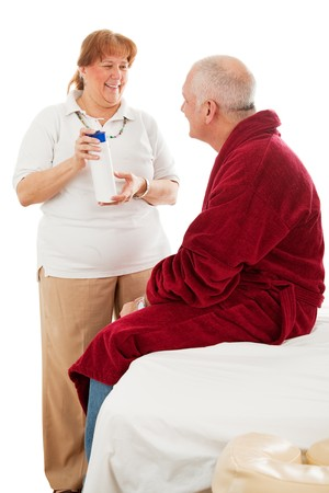 Massage therapist demonstrating her hypoallergenic lotion for a client. Isolated on white.