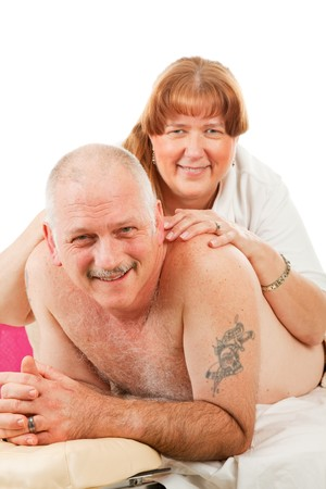 back rub: Mature married couple keeps things romatic with massage.  Isolated on white.