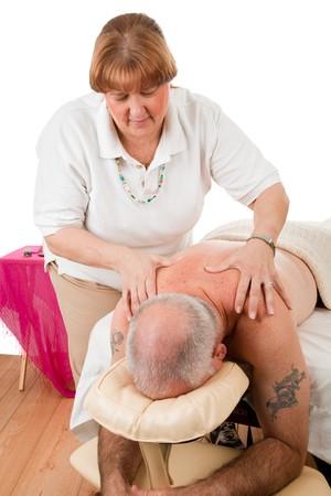 Mature man enjoying a therapeutic massage from a caring masseuse. photo